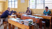 Image: (left to right) Education Volunteer Nile, English teacher Rose, math teacher Valintine
