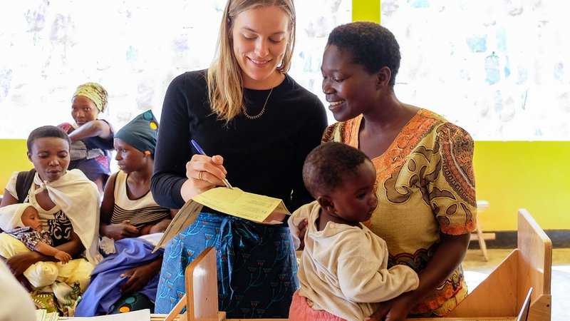 PCV Grace shows a mother the growth data collected for the baby