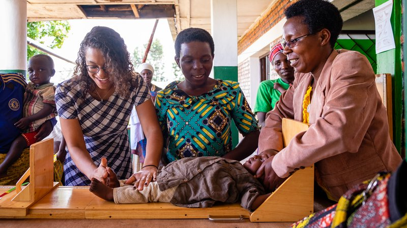 PCV Maya, counterpart, and mother measure length of baby