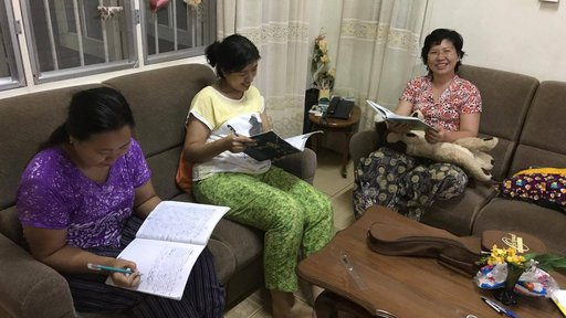 Host mom and sisters reading grammar and phrase books!