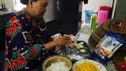 Learning to make the perfect Bakwan with my host mom.