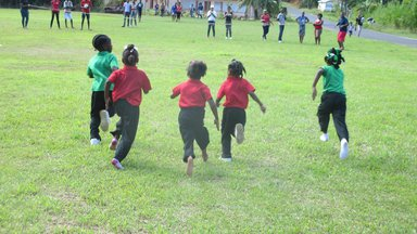 Children play during a school Sports Day in Dominica.