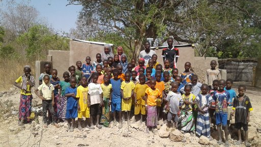 Laura Latrine - Students in front of their new latrines 2.jpg