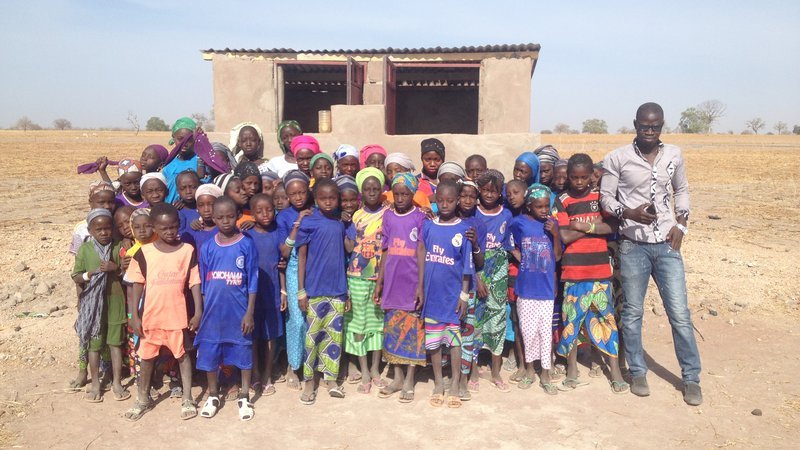 Laura Latrine - Students in front of their new latrines.JPG