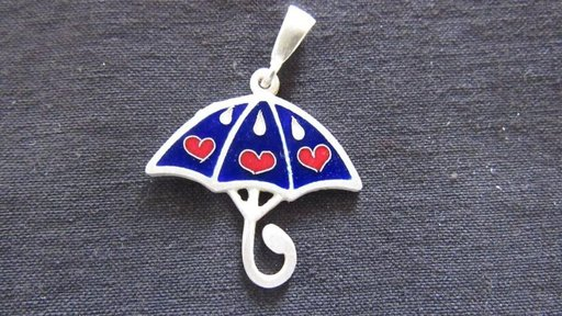 Traditional enamel jewelry made at the social enterprise