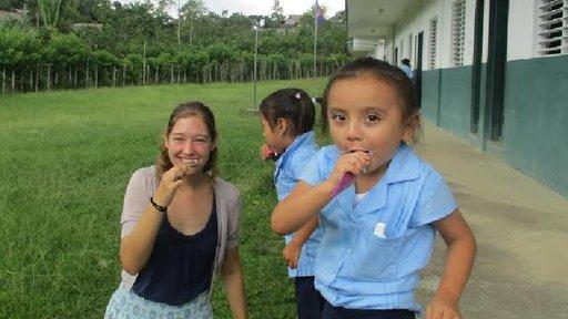 PCV Megan with child brushing their teeth.
