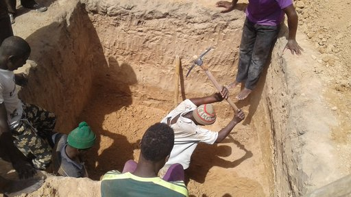 Laura Latrine - Villagers digging latrine pit.jpg