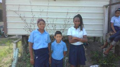 School children who were collecting plastic bottles