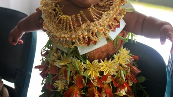 This little peanut's mom dressed her up in traditional Tongan clothing.
