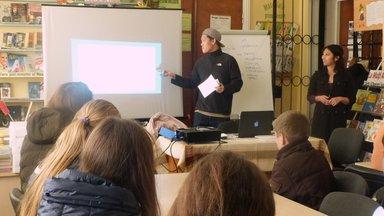 2.Volunteer Albert Sou speaks at a workshop in Costești, urging young men to help prevent gender-based violence.