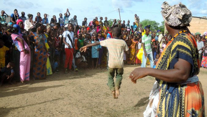While women of all ages typically dominate the drum circles in my village, some men (and energetic boys!) have crazy moves an