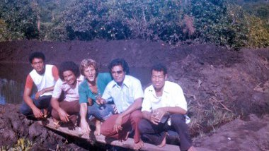 A Peace Corps Volunteer sitting with Samoan counterparts..