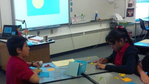 Students create the flag of Palau