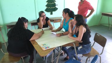 Community parents sharing ideas to encourage the positive development of their children