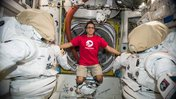 Astronaut Joe Acaba wears a Peace Corps T-shirt on the International Space Station