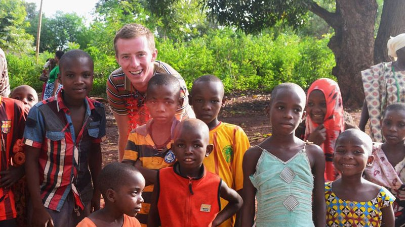 Robbie Lehman with a group of children in Tanzania
