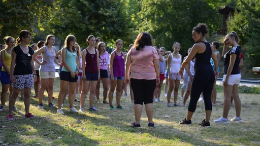 Young women take self-defense instruction at a GLOW Camp session.