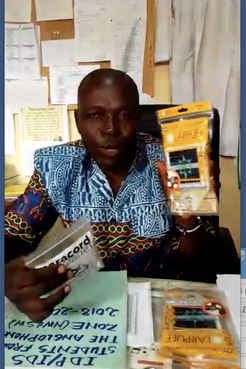 Principal of school in Cameroon with solar lamps