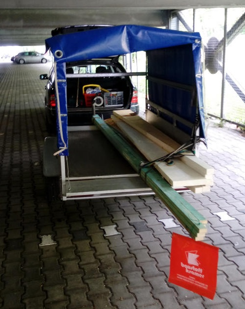 20170513 Rolf's car trailer arriving to ESOC with the woods