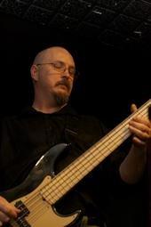 N4VOA playing bass guitar