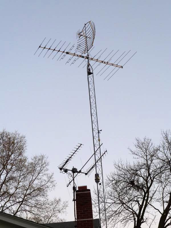 TV and ham antennas, plus weather station bolted to tower