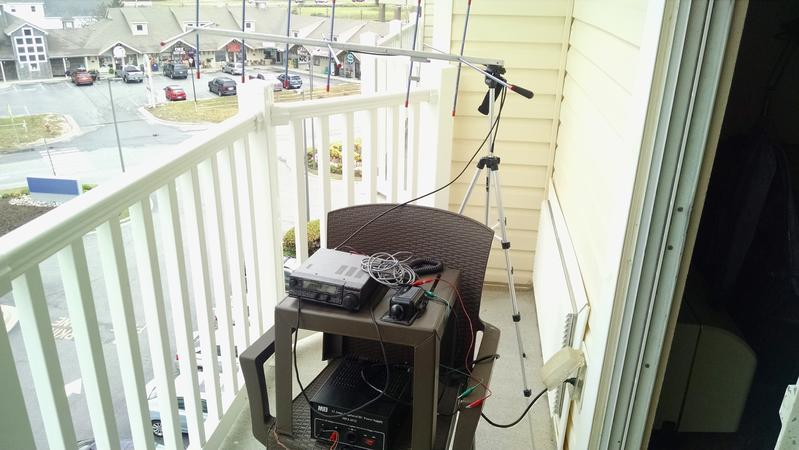 portable operation at beach, 3 el 2m yagi and kenwood tm-255a with cw key on 4th floor balcony of hotel