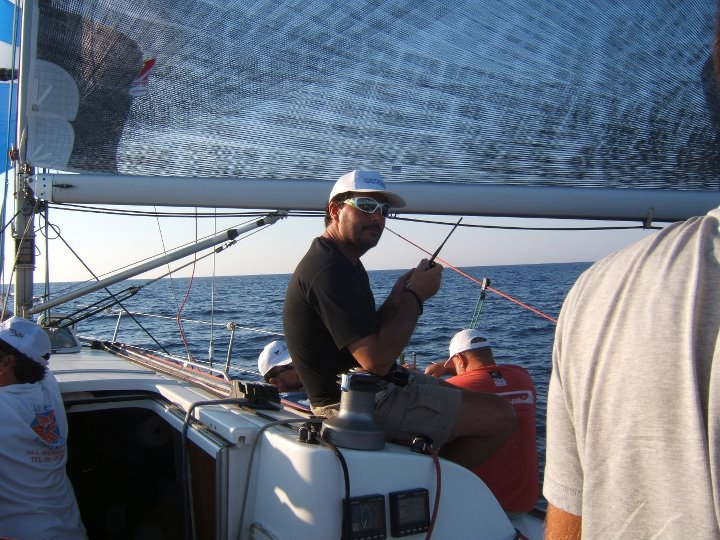 Me in the Palermo - Montecarlo 2011 regatta, in QSO with an OM to have news about others boats!