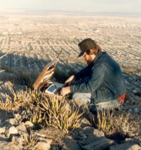 Neil W7FED playing briefcase packet on top of Mt. Franklin in El Paso, Texas