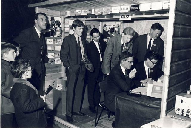 G3UOF (4th from left with hands in pockets) back in 1960s with G3LRS exhibition station