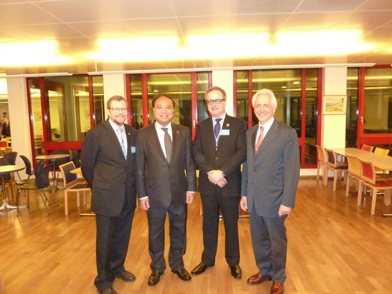 LA2RR and VE6SH with ITU Deputy SG Zao and BR Director Rancy during the IARU Reception at WRC-12