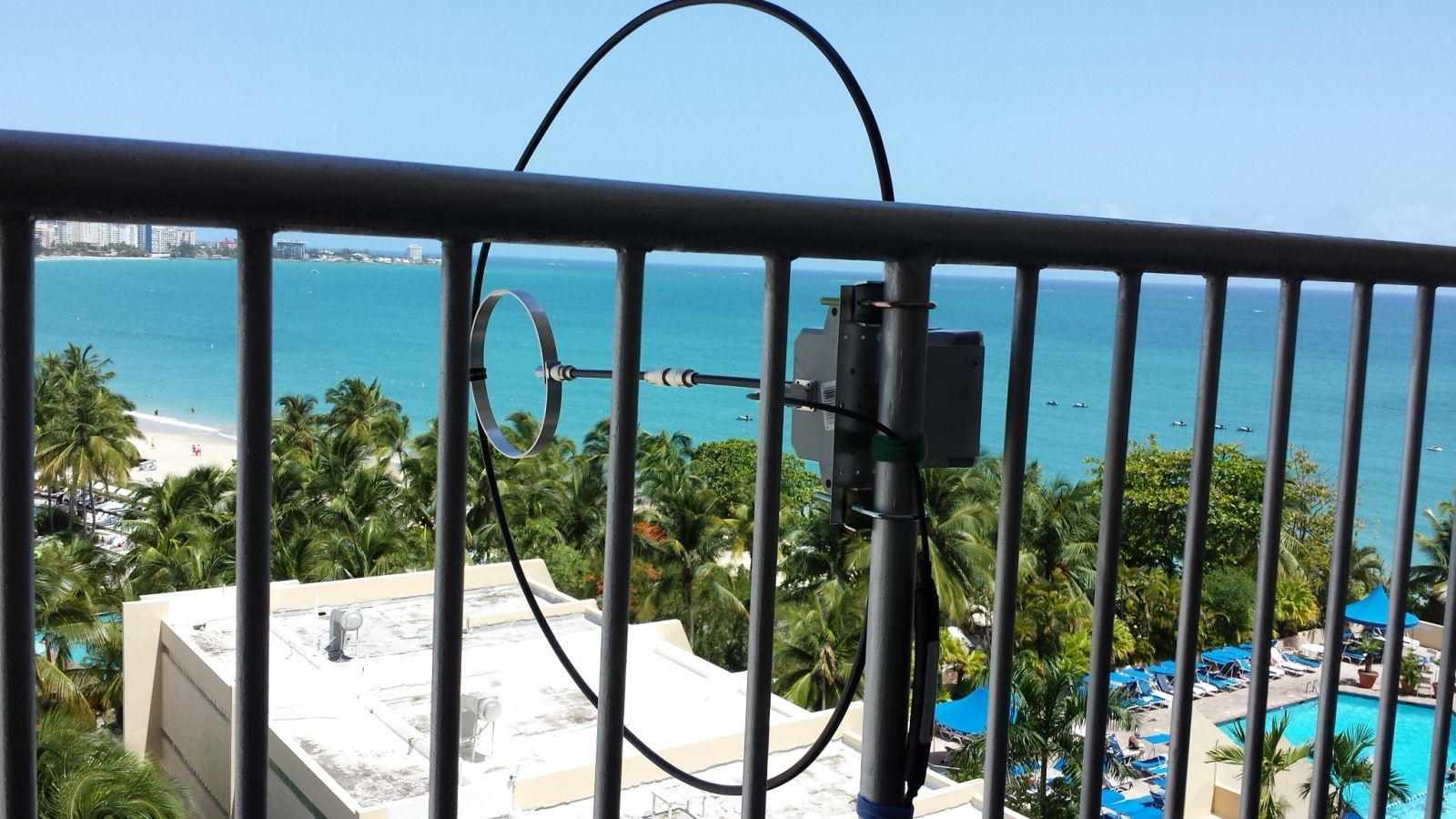 Balcony mounted Chameleon CHA F-Loop magnetic loop antenna.  View northwest toward the Atlantic Ocean and North America.