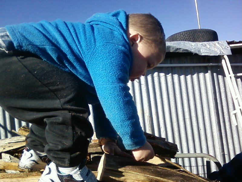 my two year old son helping unload the wood