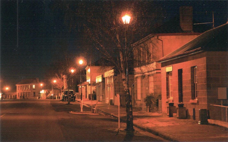 WARM WINTER GLOW OF HIGH STREET AT NIGHT