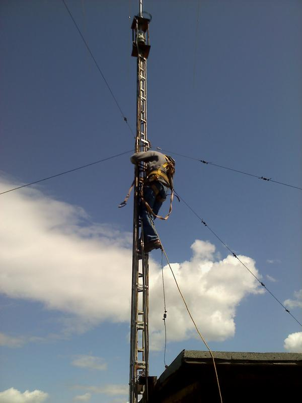 my friend dan climbing my tower to put more guide wires on so i can raise the towet more