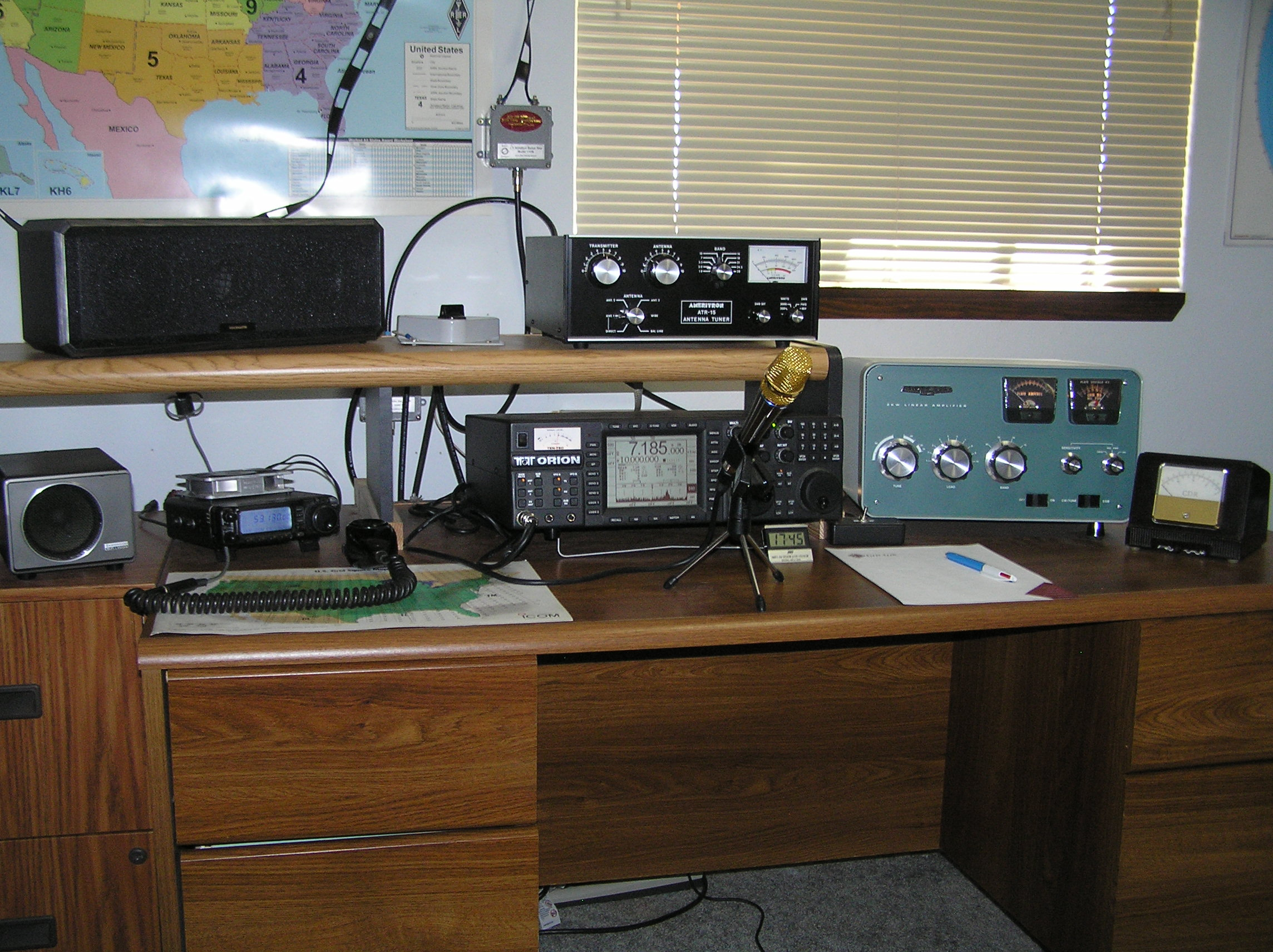 My main station as of Aug-2013 consists of a Ten Tec Orion with a Heil GM-5 Desk Mic driving a Heathkit SB-221 through an Ameritron ATR-15 Antenna Tuner. Also at the operation position is a Yaesu FT-100D that I mainly use for 6 meter FM.