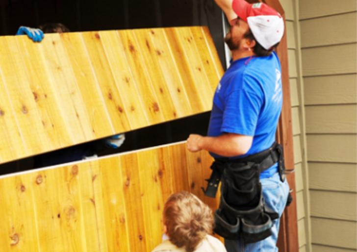 man_repairing_garage_door_with_boy-garage_door_repair_pensacola-overhead_door_&_operator_9601_n._palafox_st_ste_6-a_pensacola__fl_32534.png