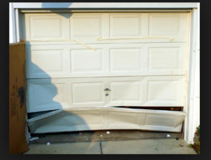 garage_door_panel_replacement-garage_door_repair_pensacola-overhead_door_&_operator.png