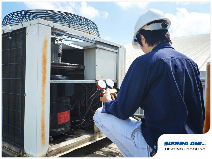 heating-and-air-conditioning-contractor-checking-hvac-equipment.jpg