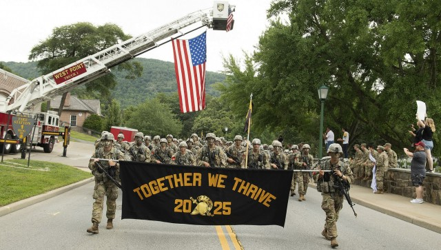 """Members of the U.S. Military Academy Class of 2025 proudly display their motto, """"Together We Thrive,"""" as they complete the final leg of a 12-mile road march from Lake Frederick to central area Monday during March Back, signifying the successful completion of Cadet Basic Training. (Photo Credit: John Pellino)"""