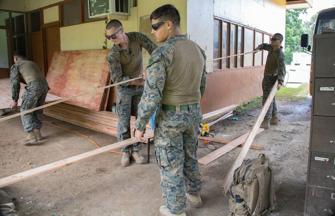 US Marine Corps engineers move wood beams