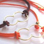 Bracelets Huit en argent ou vermeil jaune sur un lien orange ou taupe par L by l'avare pour Comptoir des Filles