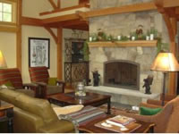 Stunning post and beam living room with stone fireplace at Attitash Mountain