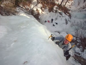 Ice climber scaling a route in the White Mountains