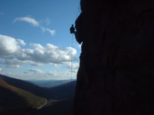 Climber rappelling a cliff in the Whte Mountains
