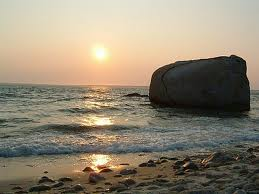 West Tisbury Waterfront at sunset with large boulder in the ocean