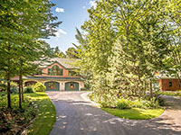 GORGEOUS contemporary Adirondack home in beautifully landscaped, certified wildlife habitat surroundings.