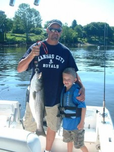 NH Lakes Region fishermen and s significant Striped Bass