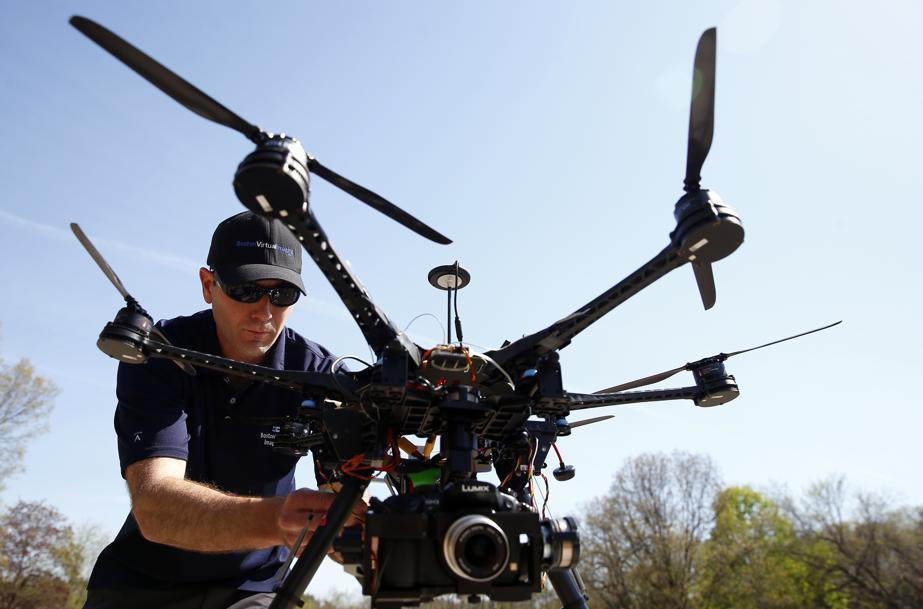 Matthew Murphy, president of Boston Virtual Imaging, prepares his drone for flight (image from bostonglobe.com | Jessica Rinaldi / Globe Staff)