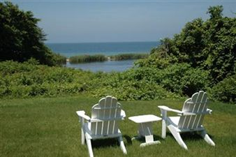 Image of lawn chairs looking out over the ocean in Hingham, MA.