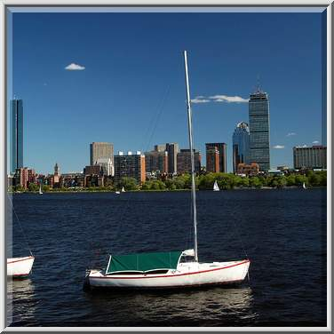 Skyline of Boston with sailboats in water in the foreground
